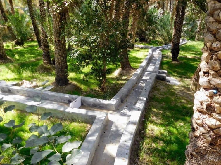 Falaj at the Al Ain Oasis, the method that waters the plants and trees. | GoNOMAD Travel