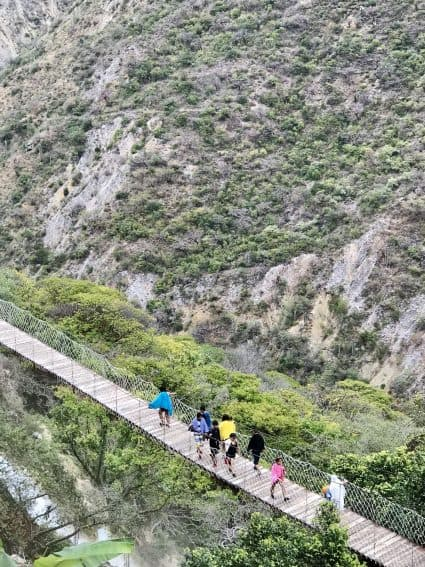 Hiking across the suspension bridge at Tolantongo. A walk for those who do not fear heights! | GoNOMAD Travel