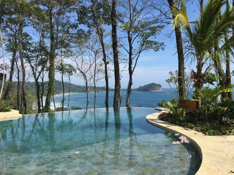 Arenas del Mar infinity pool overlooking the public and park beaches of Manuel Antonio.