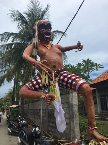 "A Paper Maiche ""Ogoh Ogoh"" effigy parades through a Balinese village ahead of the annual Nyepi celebration. Jackie Cohen Photo 