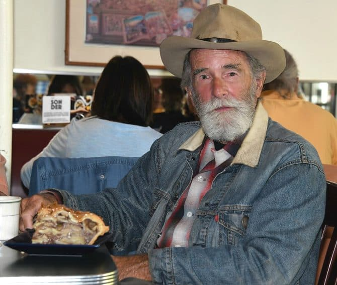 Old timer enjoying a slice of tall caramel pecan apple pie at the Plaza Cafe, Santa Fe.