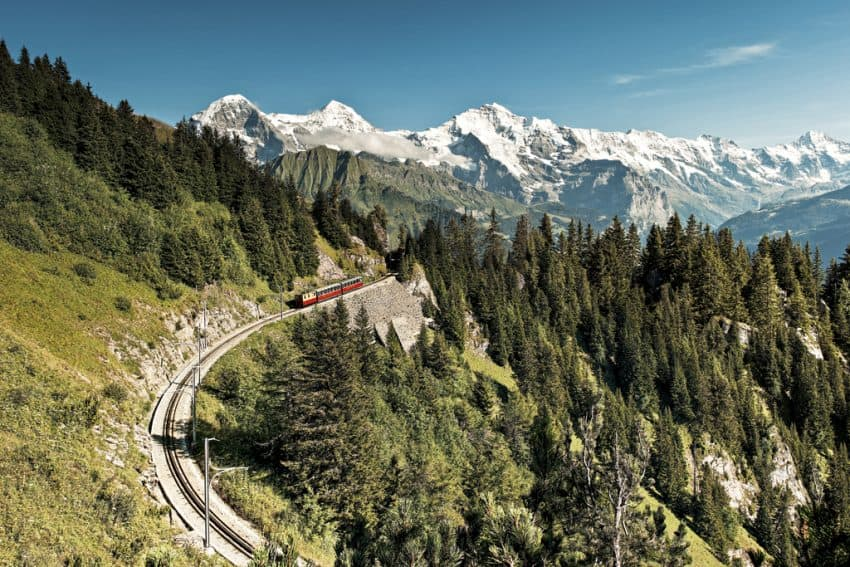 Roll through the mountains by train. Photo from the Swiss Travel System.