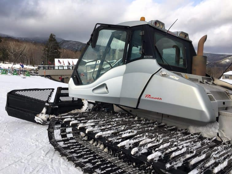 The Canadian-made Bison snow machine spends all night grooming Waterville's trails.