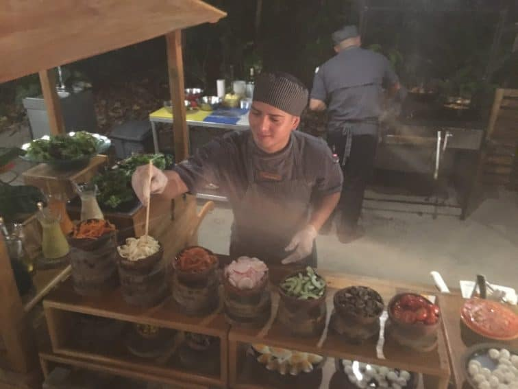 Sous chef artfully prepares a salad at Playa Playitas restaurant, Arenas del Mar