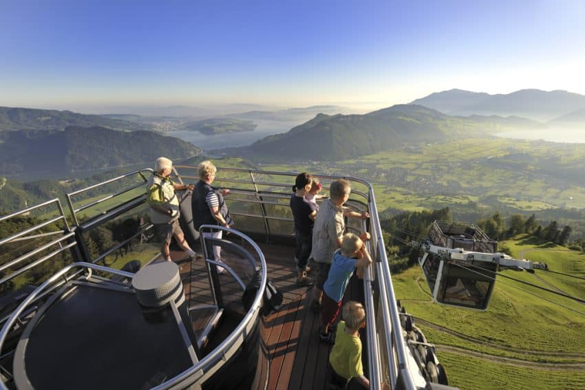 Travel up the mountainside atop a cable car. Photo from Swiss Travel System.