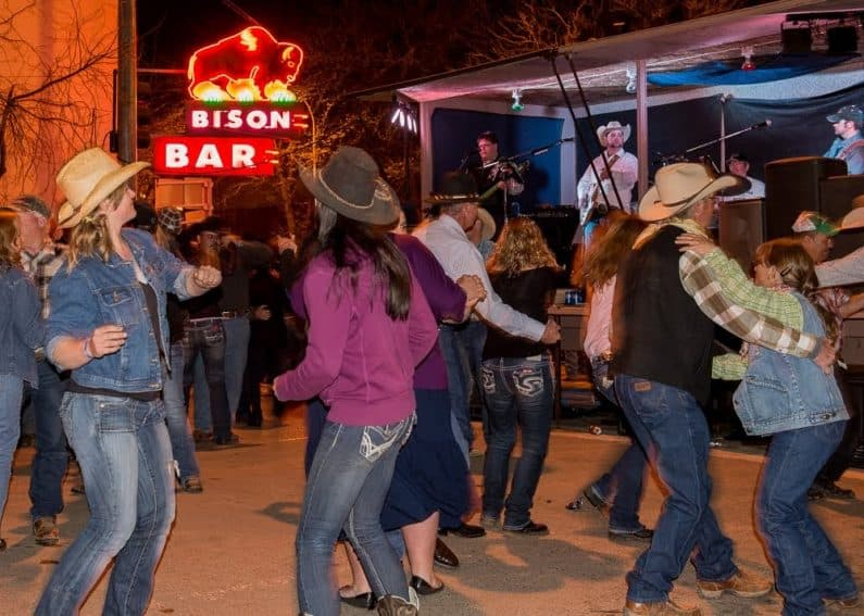 When the sun goes down, Miles City's Main Street turns into a long dance floor with multiple bands belting out country western music to the delight of the boot scooting crowd.