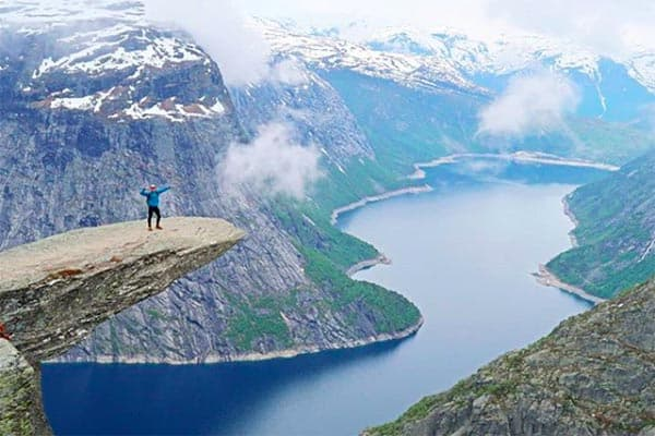 Atop Trolltanga in Norway. | GoNOMAD Travel