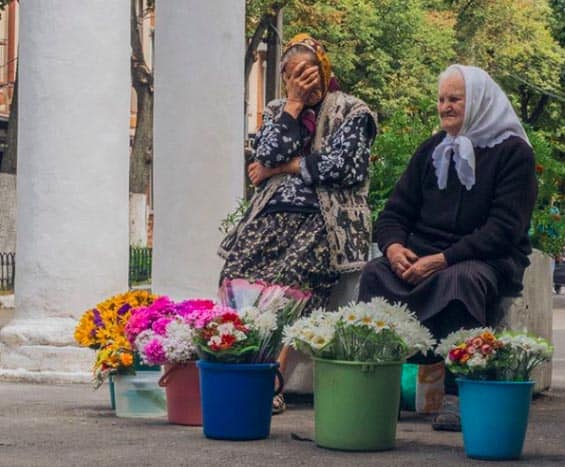 Ukrainian women selling flowers | GoNOMAD Travel