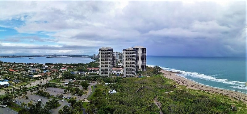 View of the nature walk and surfers after sunrise at Marriott's remote Singer Island Beach Resort on Florida's Gold Coast. | GoNOMAD Travel