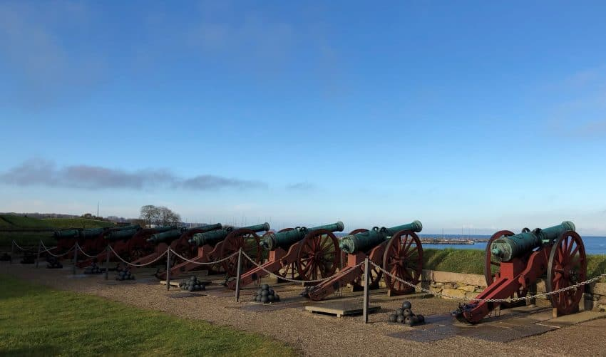 Cannons overlooking the water at Kronborg Castle, outside of Copenhagen. | GoNOMAD Travel