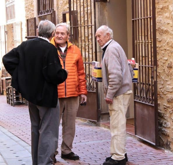 Catalonian street culture always includes finding time to chat with a neighbor.