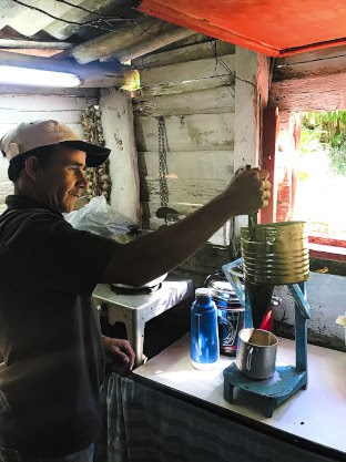 Coffee farmer Masiel brews coffee for visitors in his kitchen in Trinidad, Cuba | GoNOMAD Travel