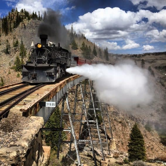 The Cumbres & Toltec Scenic Railroad runs 64 miles from Antonito CO to Chama, NM.