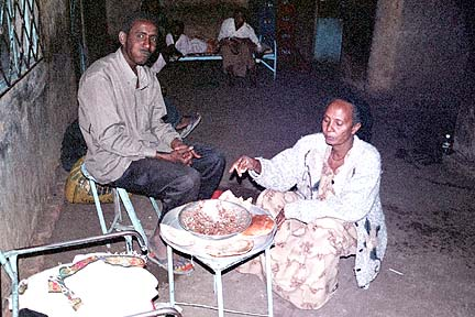 Mr. Worldly and Mother eat fuul in Gederaf's Ethiopian Compound