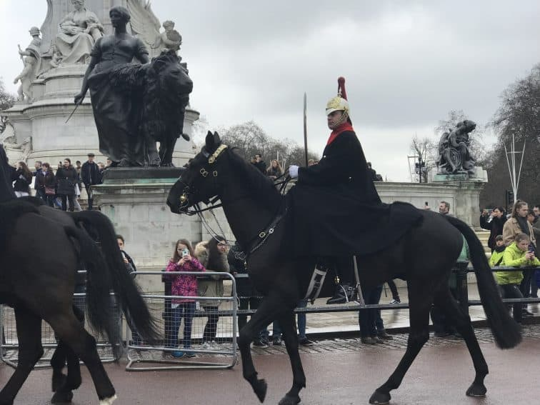 Horse and guard patrolling around the Buckingham Palace