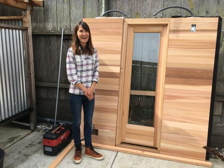 Julie Cox, a professional surfer, in front of the sauna being built at her surfer's haven, called Traveler, in Pacifica, California.   GoNOMAD Travel