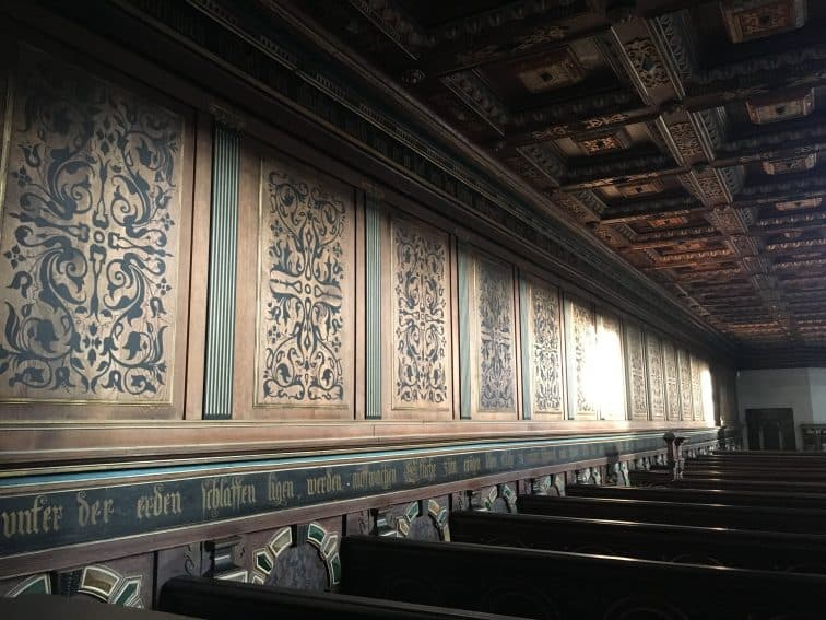 Magnificently woodcarved ceiling and pews at The Chapel at Kronborg Castle | GoNOMAD Travel