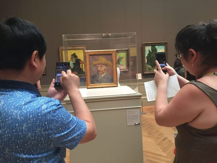 People take smartphone photos of a van Gogh painting at the Metropolitan Museum of Art in New York City. Sarah Eddy photos.