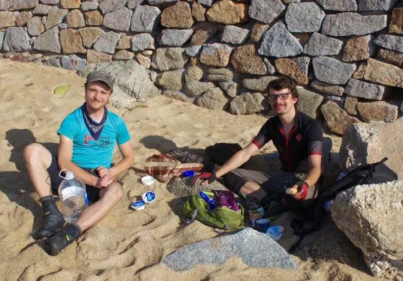 Raphael (left) and Felix enjoy a hard-earned breakfast of peanut butter, nutella and yogurt during before continuing their bicycle tour from Portugal to Greece.
