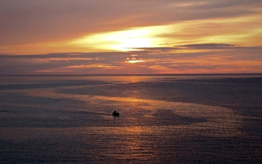 Sunrise over the Mediterranean catches a lone fisherman hard at work on Spains Costa Brava. Eric Sweigert photos.