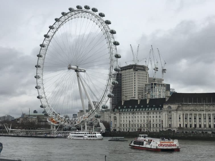The London Eye amongst the city's classically grey skies.
