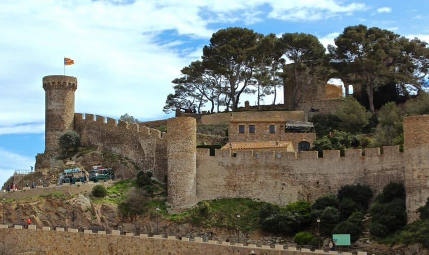 The walled old-town of Tossa de Mar once barred its gates to marauding pirates but now welcomes (mostly) the tourists that flock here in the high season | GoNOMAD Travel