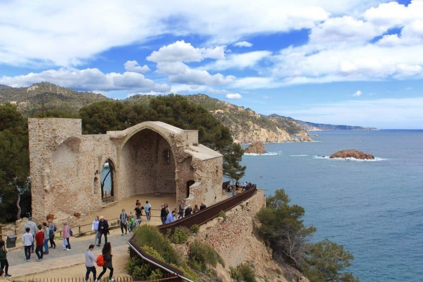 A winding path leads sightseers into and up the old, walled-town of Tossa de Mar in a remote section of the Costa Brava.