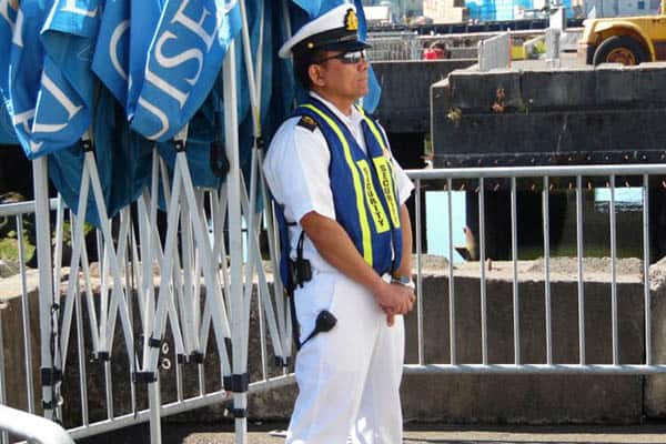 Cruise ship security at his post.   GoNOMAD Travel