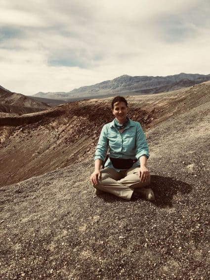 Taking a break during a long hike in Death Valley. | GoNOMAD Travel