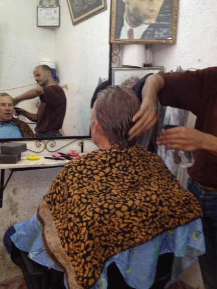 Getting a very thorough haircut in the Medina in Fes.