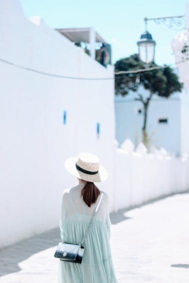 A Beautiful Mundane tourist taking in the whitewashed walls of Asilah, Morocco. MB Akinyemi photos.