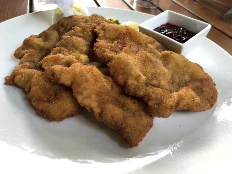 Wienerschnitzel is flat pounded veal breaded and fried, a very popular dish in Austria.