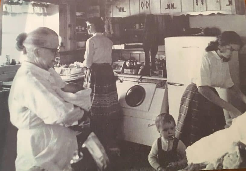 Lee Harvey Oswald's mother and wife are shown with Ruth Paine standing at the sink in her home.