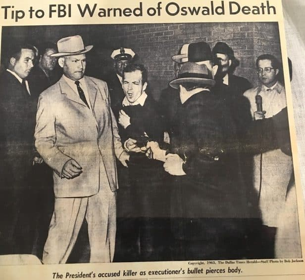 A museum newspaper clipping shows Lee Harvey Oswald being shot by Jack Ruby.