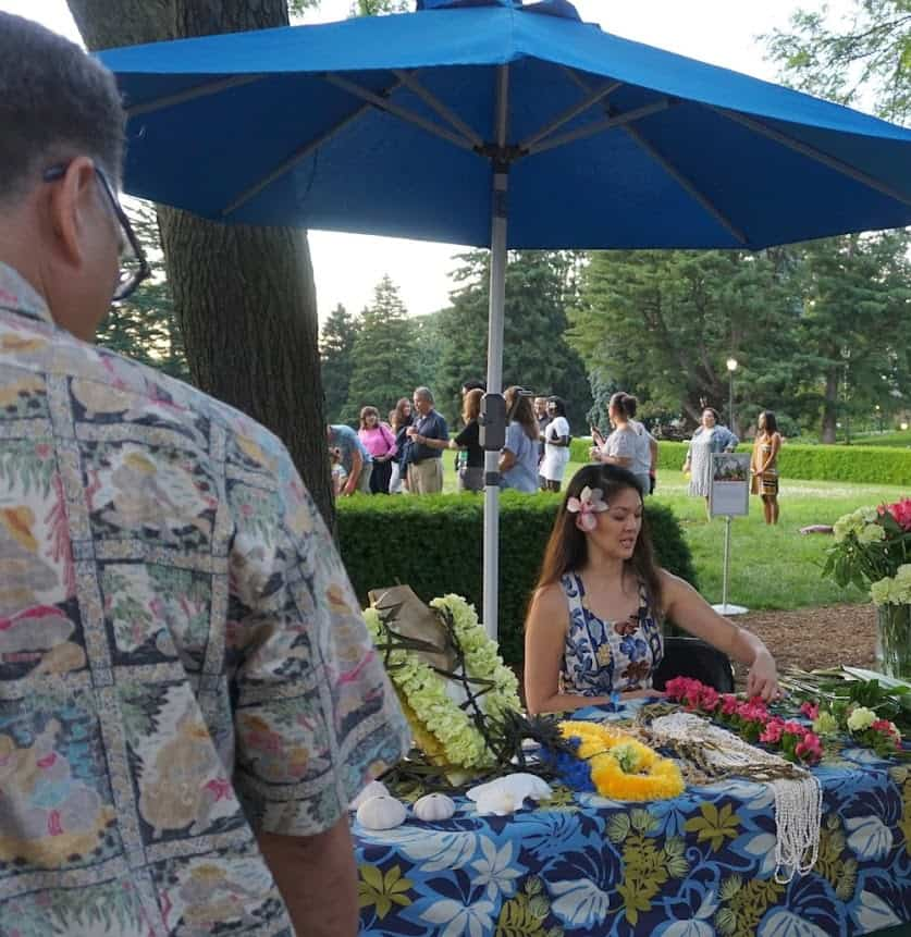 A lei-making demonstration at the Botanical Garden.
