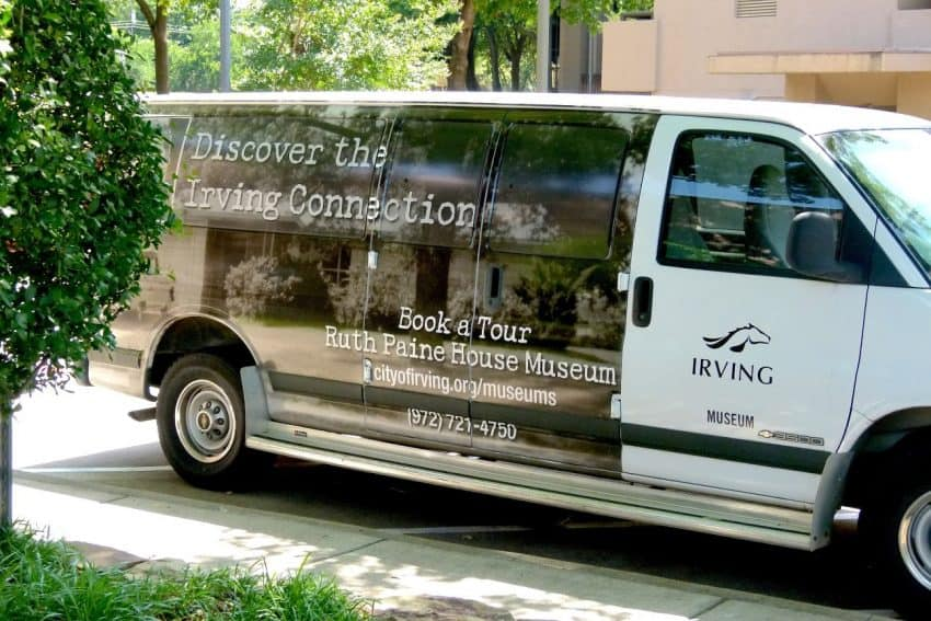 A van takes visitors to the Ruth Paine House in Irving