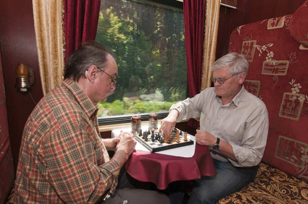 Two men playing chess as they ride the train to their next destination. Pictures from Great Dane Journeys website.