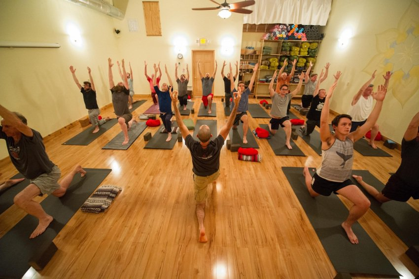 A group yoga class at Asheville Community Yoga Center.