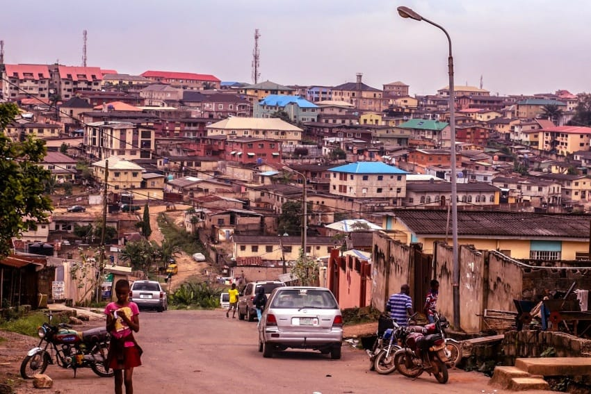 Stopped at the top of this hill as I noticed all the colored roofs- this is a street in Ogba, Lagos.