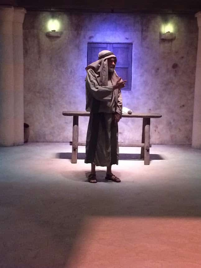 A man in period costume explains stories about the Bible at the Bible Museum in DC.