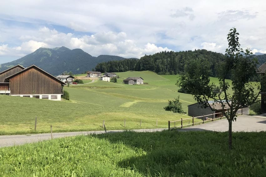 Rolling farm fields and mountains in Schwarzenberg, a small village in the Bregenzerwald region of Vorarlberg state in Western Austria. Max Hartshorne photos.