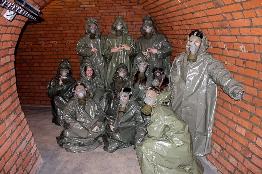 A group of Australian students are dressed for a practice drill as part of their experience in 10-Z had there been a chemical attack.