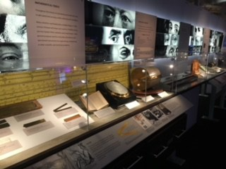 Different artifacts displayed in glass cases in the gallery.