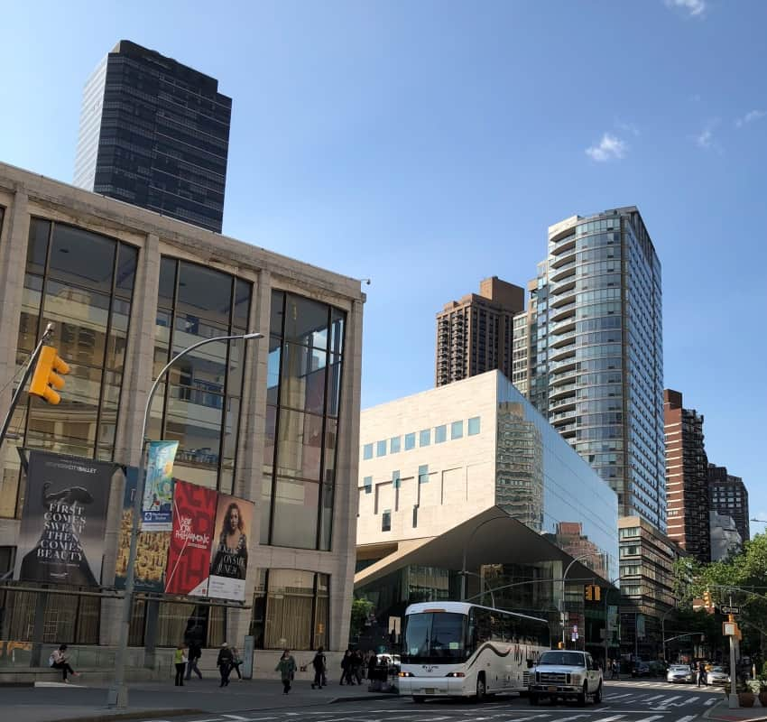 Looking at David Geffen Hall and Alice Tully Hall across Columbus Avenue and Broadway.