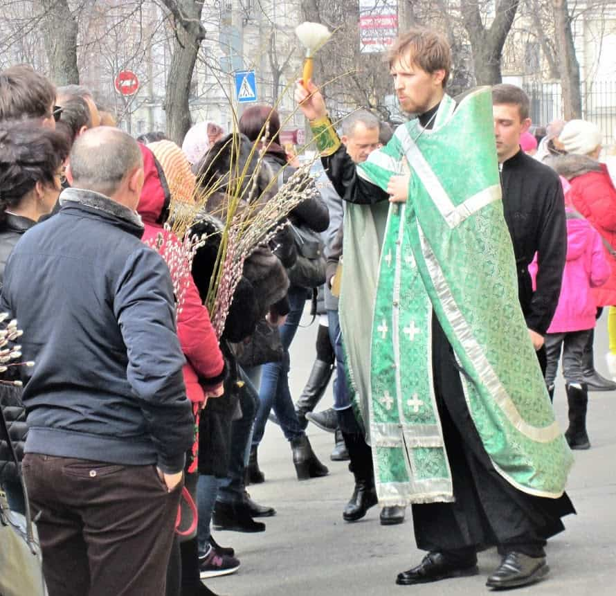 Worshippers receiving blessings at Volodymyr's Cathedral in Kyiv.