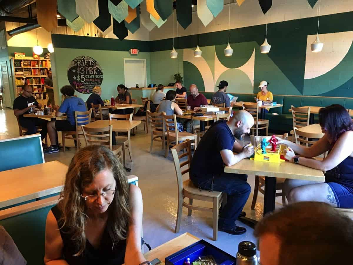 Cafe goers play different board games during their visit to the restaurant.