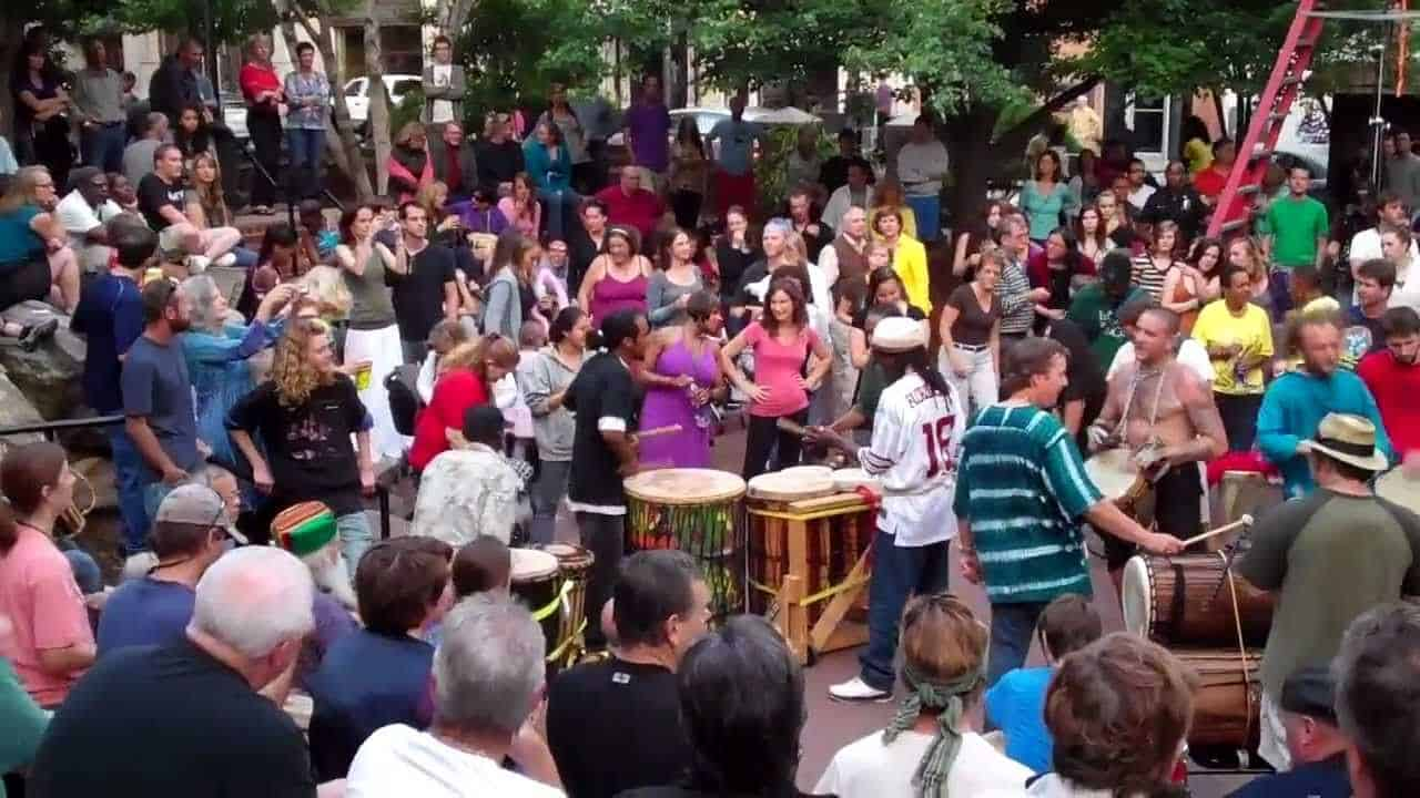 People gathered in Asheville's town square to participate in the drum circle.