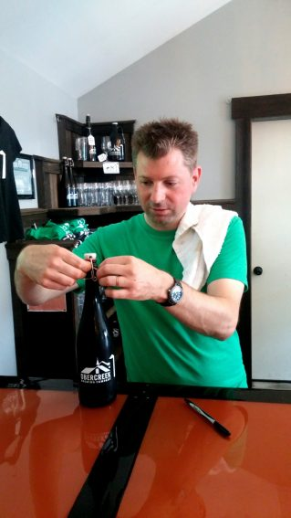 Christian Woolston readies a growler of French Press Stout which Liz tapped out at Obercreek.