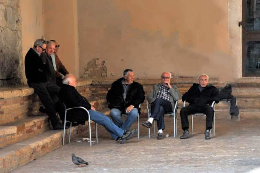 Elders in courtyard