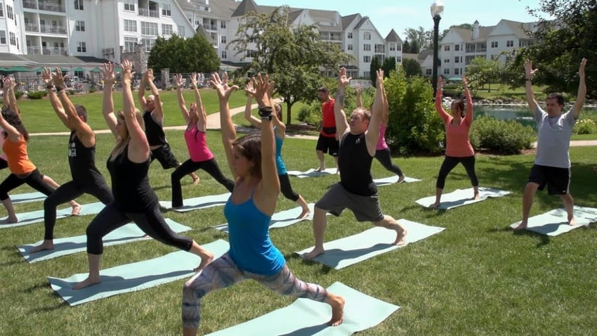 Early morning yoga is part of the Osthoff regimen in Elkhart Lake.